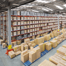 Large warehouse with pallet racking and cardboard boxes
