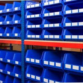 Blue small parts storage bins on a shelving system