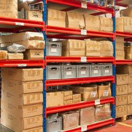 Boxes and crates stored on shelving