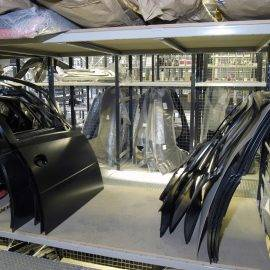 Image of car doors stored on shelving